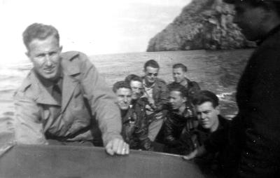 Same as previous photo, except for Jack Adams standing on left.  Man on right may be boat driver.